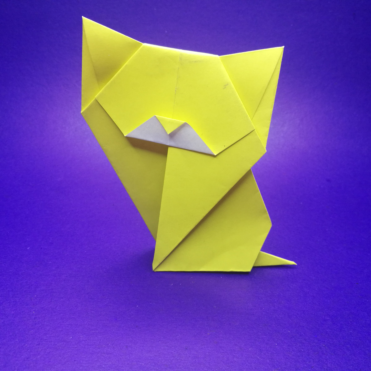 Origami sitting cat instructions and diagram on